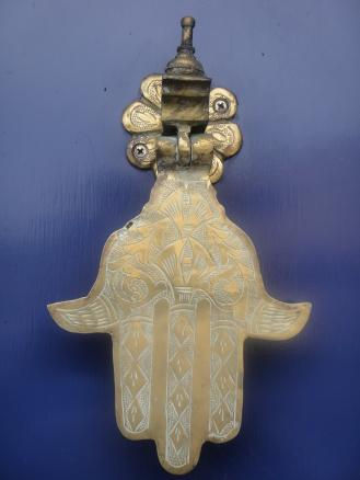 Pretty hand-shaped door knocker, San Francisco, CA
