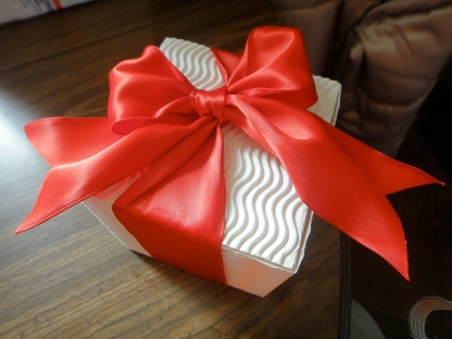 Red bow on white box