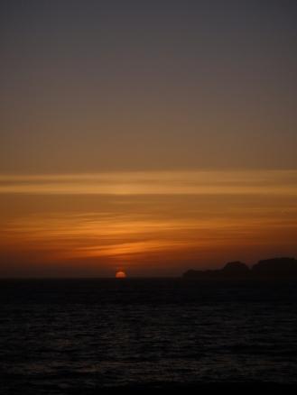 Kissing the horizon, sunset over the Pacific Ocean, Ocean Beach, San Francisco, CA (c) Winter Shanck, 2012