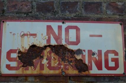 "Decaying ""No Smoking Sign outside factory wall (c) Winter Shanck, 2014"