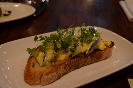 Soft-Cooked Egg Bruschetta with White Anchovies, Lemon Aioli, and Leek Confit (c) Winter Shanck, 2014