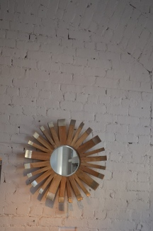 Mirror on brick wall, merchandised in a store in Savannah, GA
