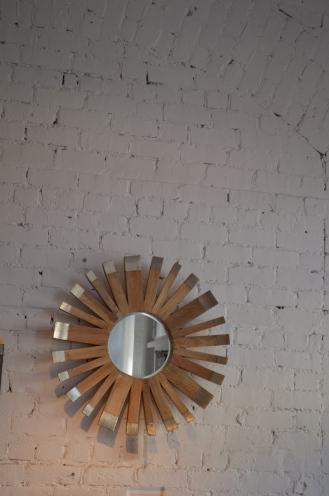 Mirror on brick wall, merchandised in a store in Savannah, GA